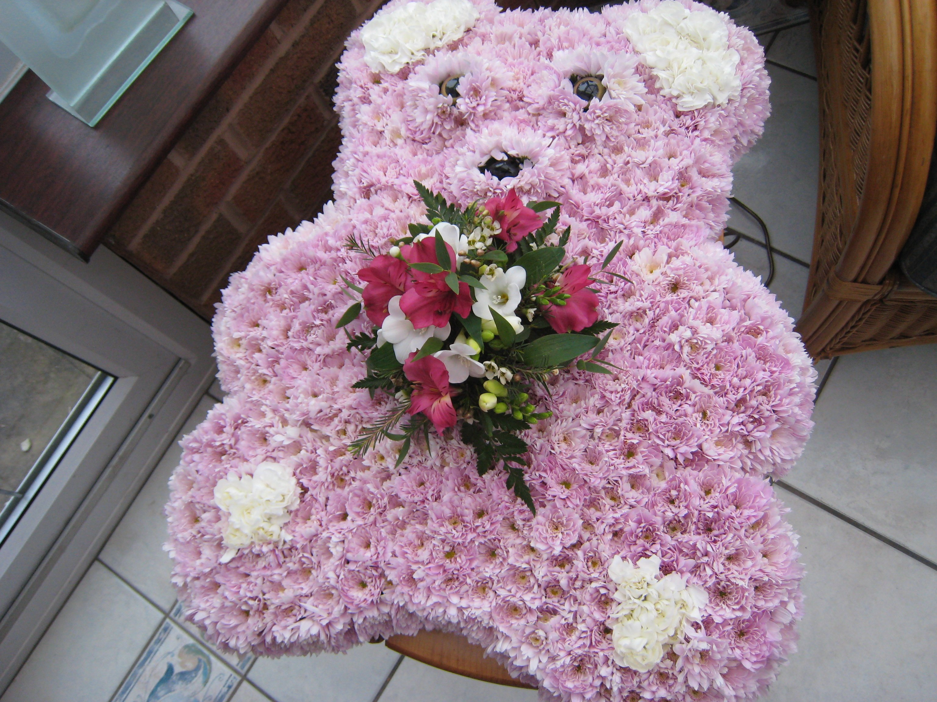 Jacaranda flowers special funeral tributes or we can add a pink or blue waistcoat to the teddy in other flowers ribbon banner lettering can be added small bear 60 large bear 75 izmirmasajfo