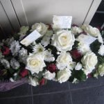 White avalanche roses and red rose small coffin spray £80